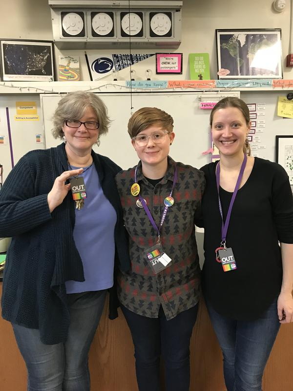 Milo Chesnut (center) and co-teachers Raka Spoerri and Beth Mowry wear their Out for Safe School badges. The badges represent being an ally to LGBTQ students.