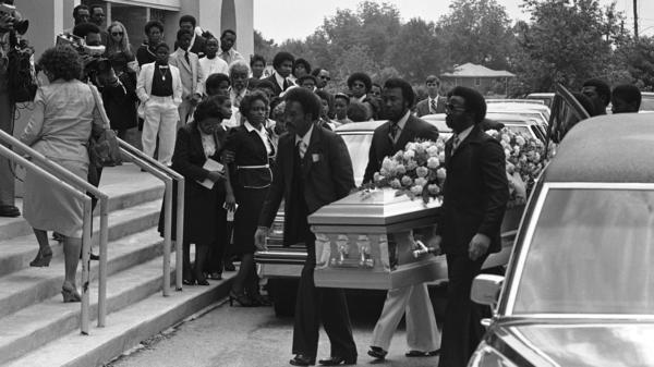 Janie Glenn (second from left) is assisted by friends as the coffin of her son, William Barrett, is carried into an Atlanta church on May 16, 1981. Barrett was the 27th young person killed in the Atlanta murders.