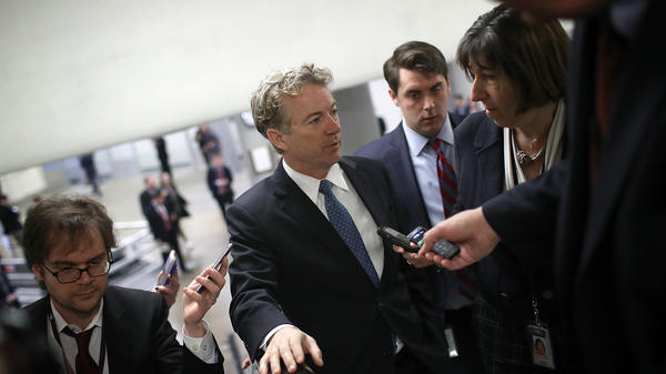 Sen. Rand Paul, R-Ky., speaks with reporters Thursday on his way to a vote on the Senate floor.
