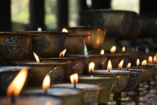 Religious butter lamps are lit by the faithful at Buddhist places of worship.<strong></strong>