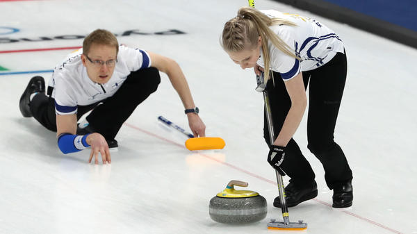 Finland's Tomi Rantamaeki, seen here delivering a stone with curling teammate Oona Kauste of Finland, is the oldest rookie at the Pyeongchang 2018 Winter Olympic Games.
