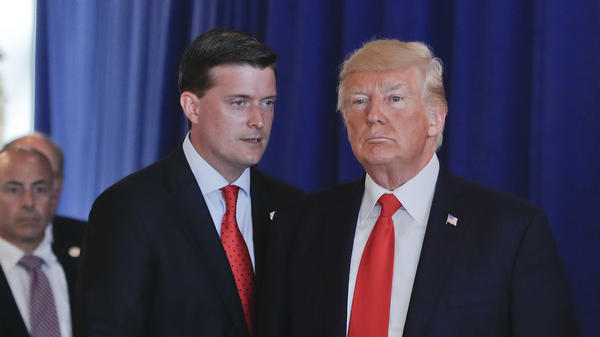 Ousted White House staff secretary Rob Porter speaks to President Trump after remarks he made on violence in Charlottesville, Va., in August 2017 at Trump National Golf Club in Bedminister, N.J.