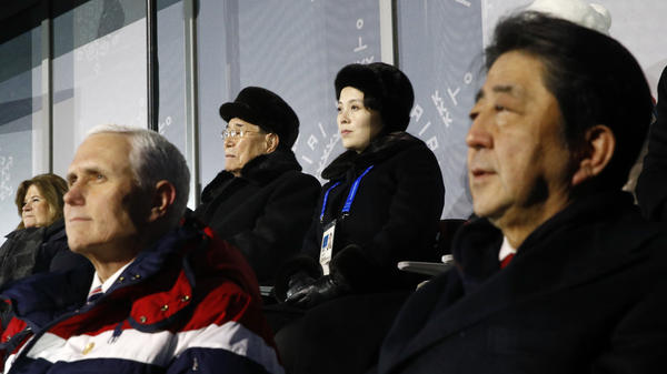 Kim Yong Nam, top left, president of the Presidium of North Korean Parliament, and Kim Yo Jong, sister of North Korean leader Kim Jong Un, top right, sit behind U.S. Vice President Mike Pence, bottom left, and Japanese Prime Minister Shinzo Abe, bottom right, as they watch the opening ceremony of the 2018 Winter Olympics in Pyeongchang, South Korea.
