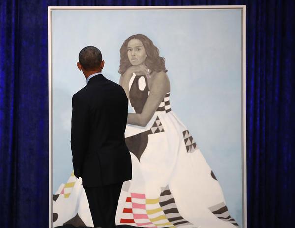 "Barack Obama gazes at his wife's newly unveiled portrait on Monday. The painting of Michelle Obama will be on display through November in the National Portrait Gallery's ""Recent Acquisitions"" section."