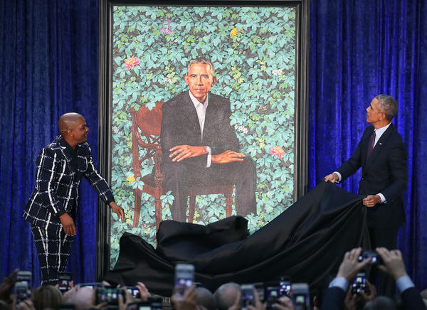 Former President Barack Obama and artist Kehinde Wiley unveil his portrait during a ceremony at the Smithsonian's National Portrait Gallery.