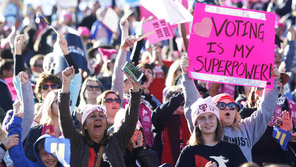 """Participants cheer a speaker during the Women's March """"Power to the Polls"""" voter registration tour launch at Sam Boyd Stadium in Las Vegas on Jan. 21."""