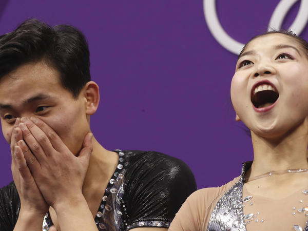 Ryom Tae Ok and Kim Ju Sik of North Korea react after their scores are posted following their performance in the pair figure skating short program on Wednesday.
