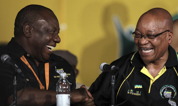 South African President Jacob Zuma (right) shares a laugh with Cyril Ramaphosa in Bloemfontein, South Africa, in 2012. Zuma resigned Wednesday and is widely expected to be replaced by Ramaphosa.