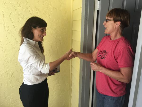 Margaret Good (left), Democratic candidate for a state House seat in Florida, campaigns for votes in Sarasota, Fla., on Monday. Good beat Republican James Buchanan by 7 percentage points in a district that President Trump won two years ago by a 5-point margin.