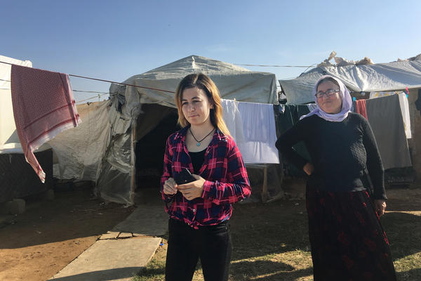 Najla Hussin and her mother at their makeshift home in a village of displaced Yazidis near Dohuk in the Kurdistan region of Iraq.