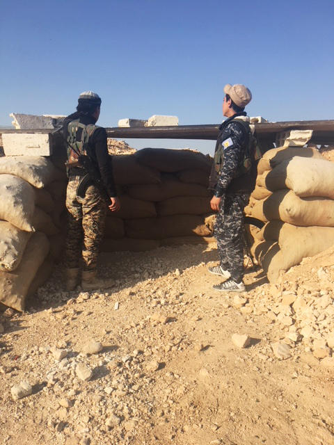 Syrian Democratic Forces stand guard at an observation post outside Manbij- near the front-line with Turkish backed forces.