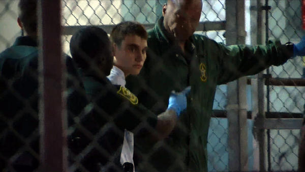 Suspect Nikolas Cruz, 19, is escorted by law enforcement at the Broward County jail in Fort Lauderdale, Fla., on Thursday.