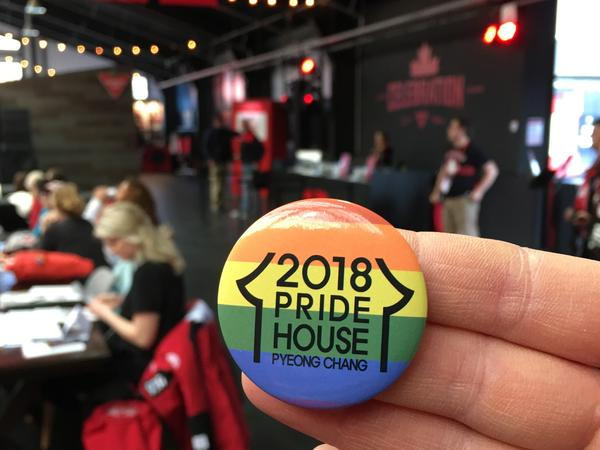 A rainbow button for Pride House Pyeongchang is seen at a display inside Canada House at the Winter Olympics in South Korea.