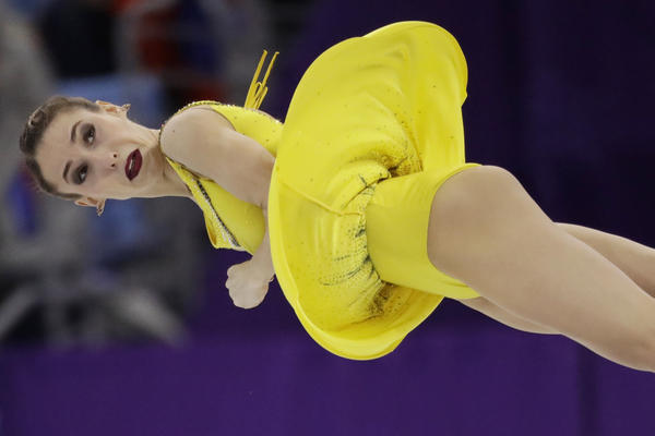 Russian skater Kristina Astakhova is airborne as she performs with partner Alexei Rogonov in the pairs free skate final.