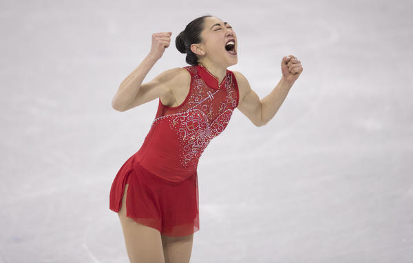 Mirai Nagasu of the United States exults after landing a triple axel during the team figure skating event. Nagasu is the first American woman to successfully complete the jump at the Olympics.