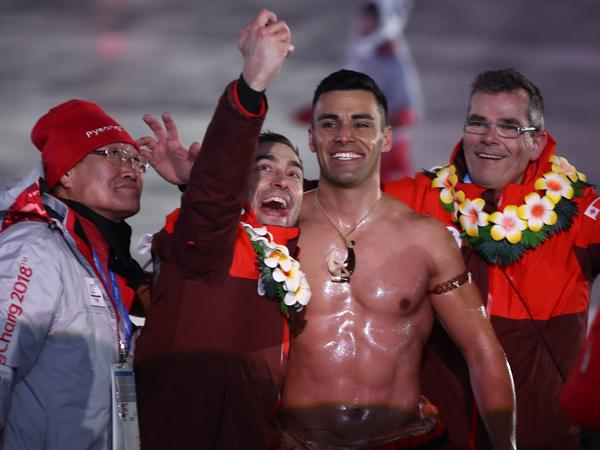 Taufatofua and another participant take a selfie during the opening ceremony.