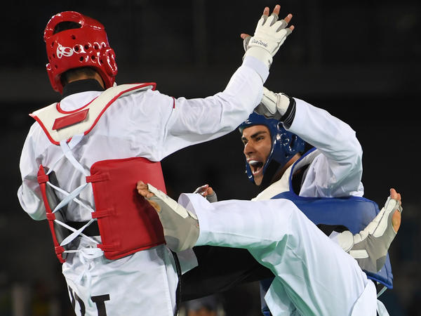 Taufatofua (right) competes against Iran's Sajjad Mardani in the men's taekwondo qualifying bout at the 2016 Rio Olympics.