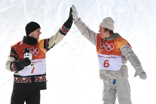 Seventeen-year-old Red Gerard (right), the first Team USA gold medalist of the Pyeongchang Games, gives Canadian silver medalist Max Parrot a high-five during the victory ceremony for men's snowboard slopestyle.