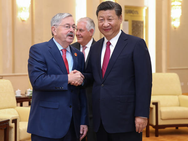 U.S. Ambassador Terry Branstad shakes hands with Chinese President Xi Jinping at the Great Hall of the People on Sept. 30 in Beijing, China.
