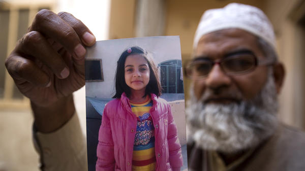 Mohammed Amin shows a picture of his 7-year-old daughter, Zainab Ansari, in Kasur, Pakistan, on Jan. 18. On Saturday, a 24-year-old local man, found guilty in her murder, was sentenced to die.