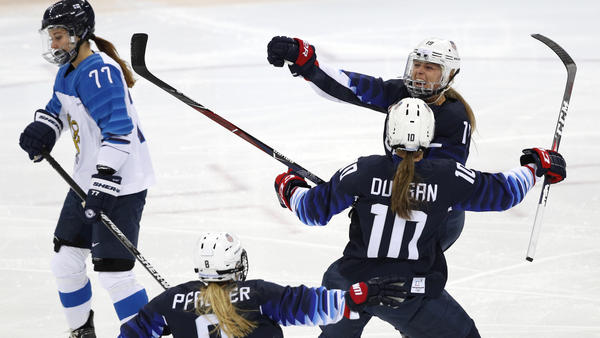 Gigi Marvin of the U.S., rear right, celebrates her goal in the first period of the women's semifinal match against Finland on Sunday. The victory sends the Americans to the gold medal match at the Pyeonghang Winter Olympics