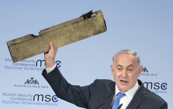 At the Munich Security Conference in Munich on Sunday, Israeli Prime Minister Benjamin Netanyahu holds a part of a downed drone that he said came from an Iranian drone shot down over Israeli airspace earlier this month.