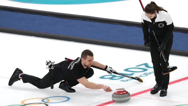 Aleksandr Krushelnitckii, seen here competing with his teammate and wife Anastasia Bryzgalova, has tested positive for a banned substance, the Olympic Athletes from Russia says. The pair won a bronze medal at the Pyeongchang Winter Olympics.
