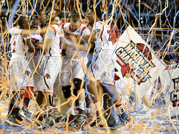 The Louisville Cardinals celebrate after they won the 2013 NCAA men's basketball national championship against Michigan. On Tuesday, the NCAA upheld its 2017 ruling that Louisville must vacate its records from 2011 to 2015, including its national title.