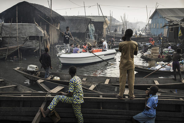 "A group of American expats in Lagos<strong> </strong>is steered through the canals of Makoko, ""a slum €""on the shores of Lagos, Nigeria."