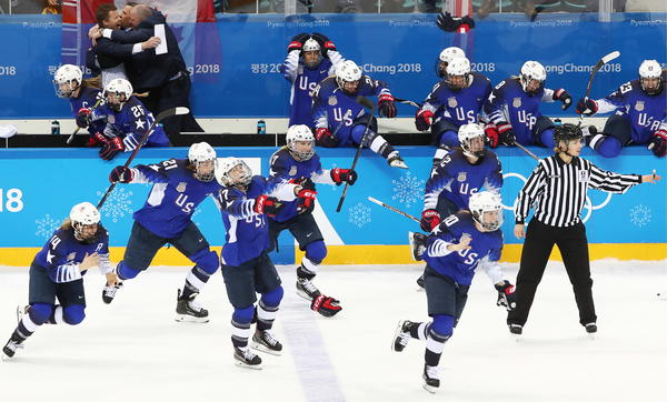 The U.S. women's hockey players celebrate winning gold medals in the women's final ice hockey game against Canada at the Gangneung Hockey Center during the Pyeongchang Winter Olympics.