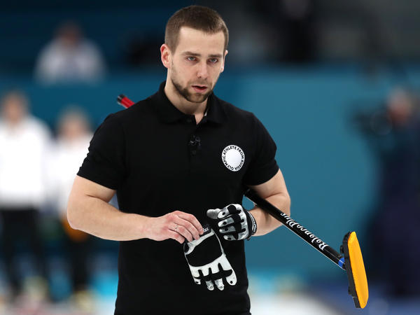 Aleksandr Krushelnitckii, seen during the bronze medal game against Norway last week. The Olympian from Russia won that mixed doubles bronze — but had the medal stripped Thursday for testing positive for a banned substance.