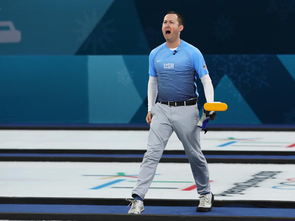American curler Tyler George celebrates the U.S. team's upset over Canada during the semifinal round Thursday. The stunner puts the U.S. into the gold medal round, where Sweden awaits.