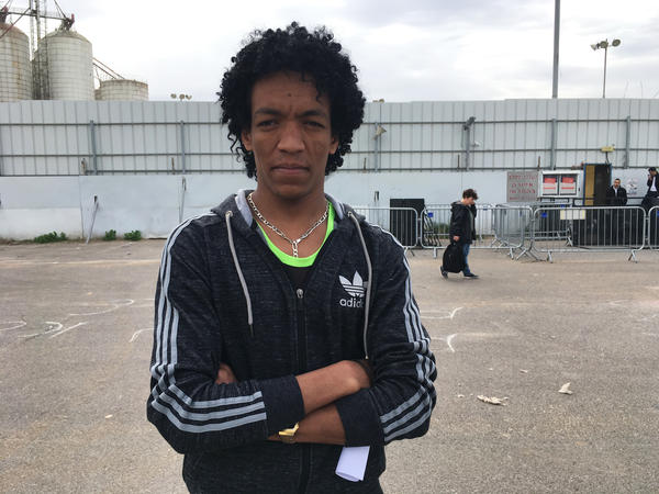 Mehretab Seyim, 28, holds a deportation notice he just received at an Israeli government immigration office in the Israeli city of Bnei Brak. The notice is written in Hebrew and Tigrinya, one of the languages spoken in Eritrea.