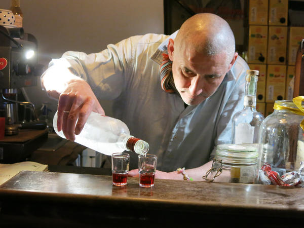 """Hungarian Akos Szepessy, 49, pours shots of chilled vodka and raspberry syrup called <em>Teraz</em> <em>Polska</em>, meaning<em> </em>""""Now, Poland,"""" because it forms the red and white colors of the Polish flag. It's a favorite drink at a bar in Budapest called Gdansk that he and his Polish wife own and named for the Polish port city on the Baltic."""