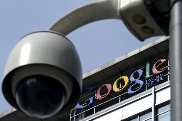 In this March 23, 2010 file photo, a surveillance camera is seen in front of the Google China headquarters in Beijing, China. (AP Photo/Andy Wong, File)