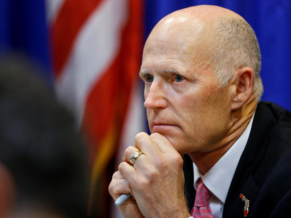 Florida Gov. Rick Scott wants a range of measures aimed at preventing shootings like the one last week at a high school in Parkland, Fla. Scott is seen here during a meeting with law enforcement, mental health and education officials on Tuesday.