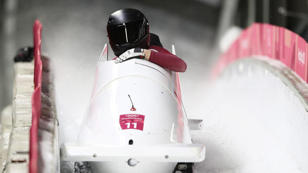 Nadezhda Sergeeva and Anastasia Kocherzhova, competing as Olympic Athletes from Russia, react in the finish area during the women's bobsleigh heats on Wednesday in the Pyeongchang Olympics.