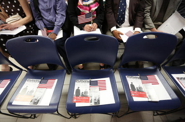 Citizenship candidates wait for a naturalization ceremony to begin in downtown Manhattan on July 2, 2013 in New York City. U.S.