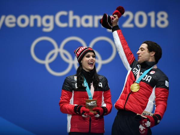 Canada's gold medalists Tessa Virtue and Scott Moir celebrate on the podium during the medal ceremony for the figure skating ice dance. The 2018 Winter Games have seen the country win 29 medals.