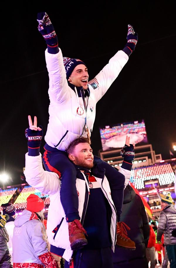 U.S. athletes Adam Rippon and Gus Kenworthy parade with other delegations during the closing ceremony of the Pyeongchang 2018 Winter Olympic Games.