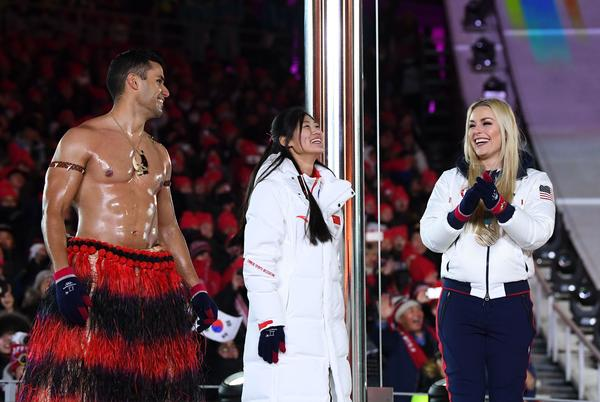Tongan cross-country skier Pita Taufatofua (left) once again marched bare-chested in frigid weather and met onstage with China's silver medalist snowboarder Liu Jiayu and U.S. bronze medalist skier Lindsey Vonn.