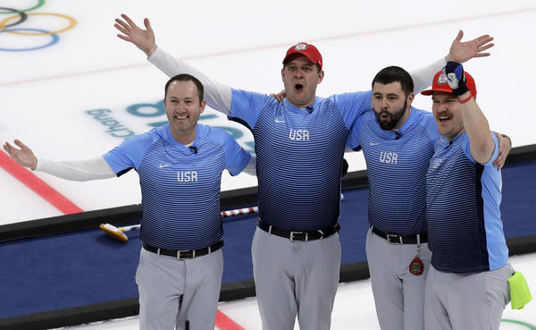 The U.S. men's curling team celebrates its surprise win over Sweden on Feb. 24. It was the first team gold in the sport by an American team.