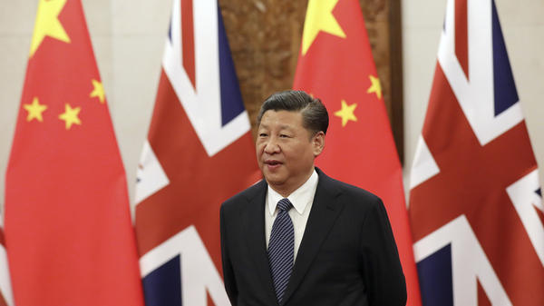 Chinese President Xi Jinping earlier this month waits for British Prime Minister Theresa May ahead of a meeting at the Diaoyutai State Guesthouse in Beijing. Xi is coming to the end of his first term and is expected to be appointed to a second term in March.