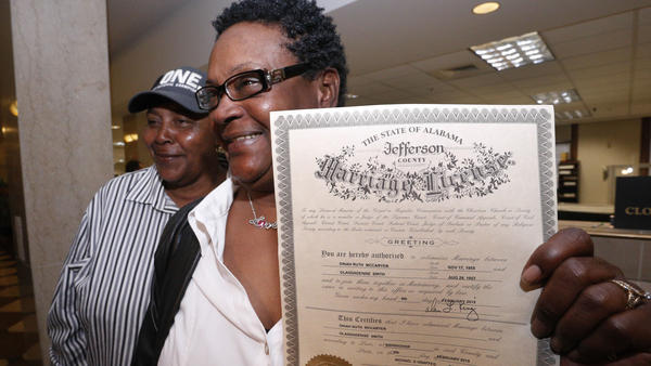 Olanda Smith (left) and Dinah McCaryer were the first to marry in Jefferson County on Monday, Feb. 9, 2015, after a federal judge overturned the state's ban on same-sex marriage. Several other counties refused to issue marriage licenses that day.