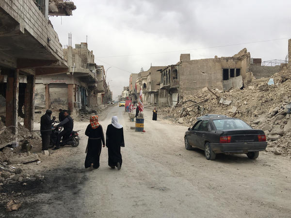 More than eight months after the battle ended the government hasn't restored electricity or running water in Mosul's Old City. Hundreds of residents with nowhere else to go have come back to try to live in their damaged houses.
