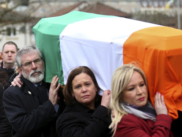 Sinn Fein's Gerry Adams, left, Mary Lou McDonald and Michelle O'Neill carry the coffin of former IRA commander and Sinn Fein deputy leader Martin McGuinness to St. Columba's Church in Londonderry, Northern Ireland, on March 23, 2017. McGuinness helped lead his militant movement to compromise with British Protestants.