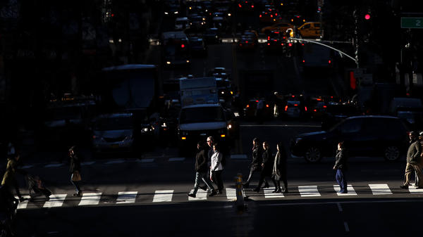 Pedestrians cross the street as traffic moves along 42nd Street in Midtown Manhattan on Jan. 25.