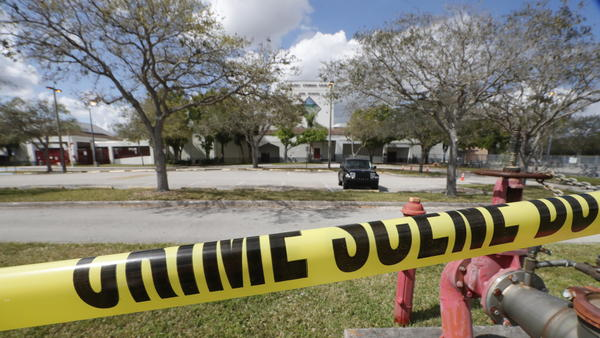 Crime scene tape runs outside Marjory Stoneman Douglas High School in Parkland, Fla., on  Sunday, Feb. 18., a few days after the shooting that left 17 people dead.