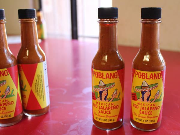 The Segura family has sold Poblano Mexican Hot Sauce since 1924. The condiment (available in four flavors) embodies Tucson: traditional, vibrant and heavy on the <em>chiltepín</em>, a tiny, wild pepper that starts fruity, then burns long and strong.