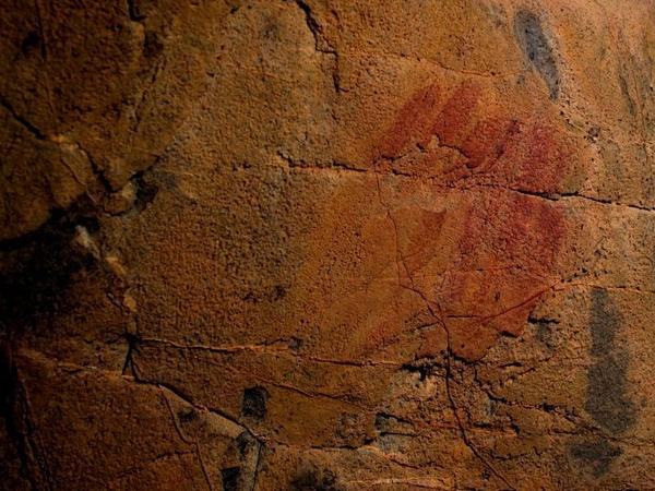 Picture shows what scientists say are Neanderthal cave-paintings inside the Andalusian cave of Ardales, on March 1, 2018. The cave-paintings, found in three caves in Spain, were created between 43,000 and 65,000 years ago, at least 20,000 years before modern humans are believed to have arrived in Europe.